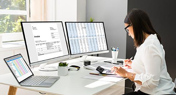 woman manually creating internal audit reporting