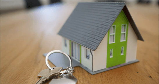 mortgage automation: house with keys sitting next to it